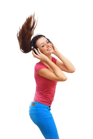 Happy smiling girl dancing and listening to music Stock Photo
