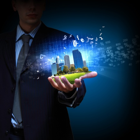 Image of a modern cityscape in the hand of a businessman photo