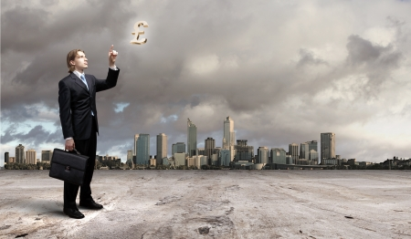 Image of a business man standing against cityscape photo