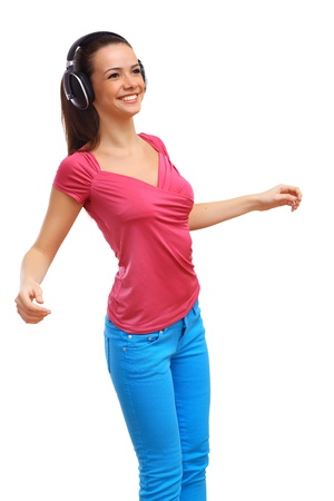 Happy smiling girl dancing and listening to music Stock Photo - 18746316
