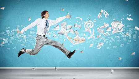 Image of a businessman jumping high against financial background Stock Photo - 18767922
