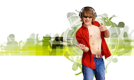 Happy smiling young man dancing and listening to music Stock Photo - 18767819