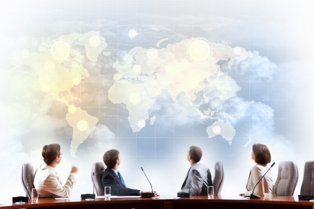 corporate image: Image of businesspeople at presentation looking at virtual project