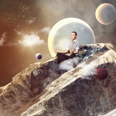 Businesswoman sitting in lotus flower position against space background photo