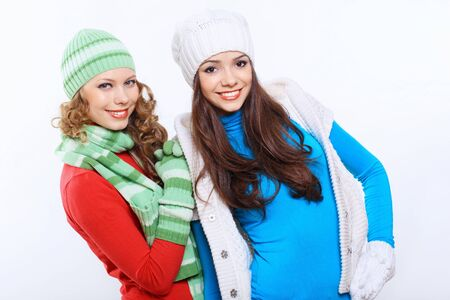Young pretty woman in warm winter hat and scarf Stock Photo - 18767894
