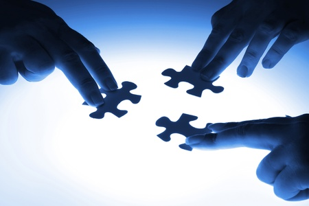 communication metaphor: puzzle piece coming down into its place Stock Photo