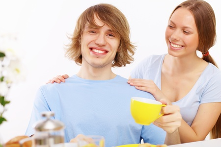 Young couple together at home having tea photo