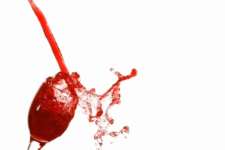 Red Juice splash isolated on white background photo