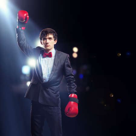 Portrait of a young businessman boxing  conceptual collage photo