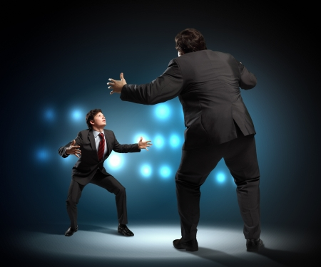 contestation: Image of businesspeople arguing and acting as sumo fighters Stock Photo