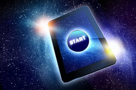 hit tech: Great tablet with a beautiful Start button on the starry night sky  Stock Photo