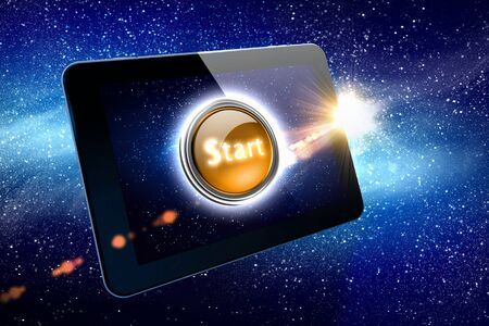 Great tablet with a beautiful Start button on the starry night sky  photo