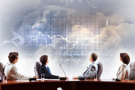 analytics: Image of businesspeople at presentation looking at virtual project