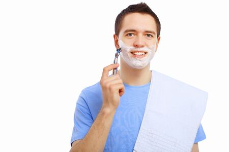 Young man at home shaving himself in the morning photo