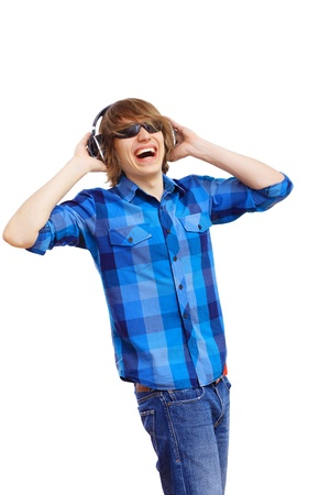 Happy smiling young man dancing and listening to music Stock Photo - 18972970