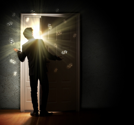 back to the future: Image of young businessman standing with back opening door against dollar sigh background Stock Photo
