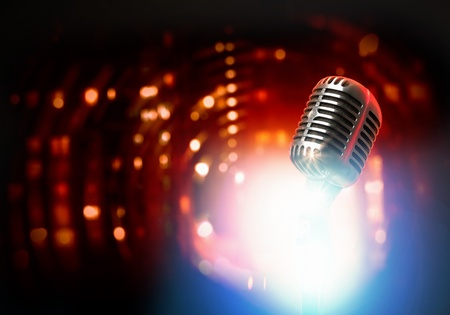 Let s sing  Stylish retro microphone on a colored background Stock Photo - 18972922