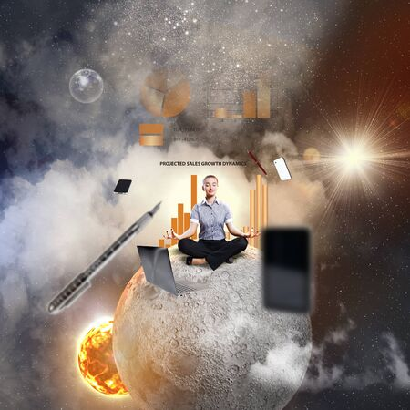 aloft: Businesswoman sitting in lotus flower position against space background with office stuff aloft