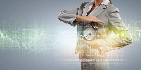Image of businesswoman holding alarmclock against illustration background illustration