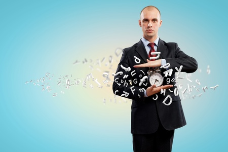 Image of businessman holding alarmclock against illustration background  Collage illustration