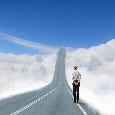 road ahead: Concept of the road to success with a businesswoman standing on the road Stock Photo
