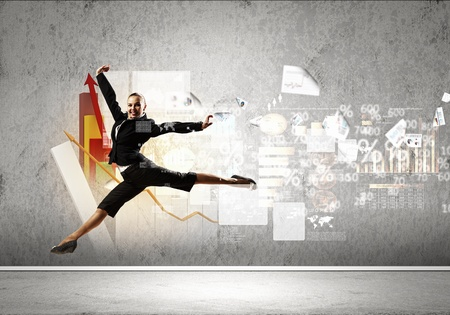 Image of pretty businesswoman jumping high against financial background photo