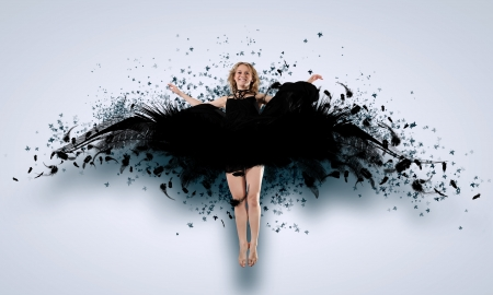 Woman floating in a dance on dark wings  Collage  photo