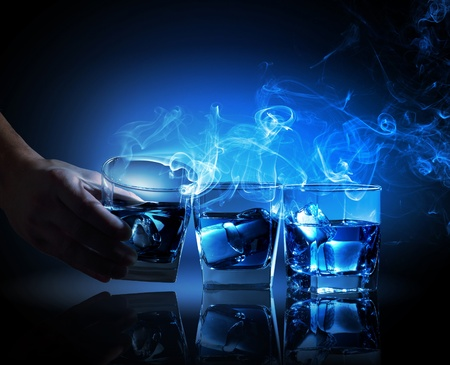 fume: Three glasses of blue cocktail with fume going out