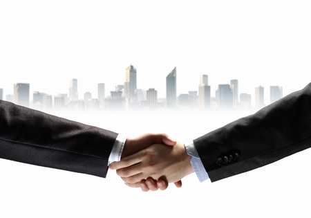 business handshake against white background with city image Stock Photo - 19195783