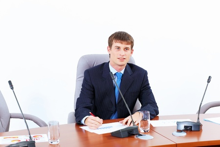Image of young businessman sitting at table at business meeting Stock Photo - 19195700