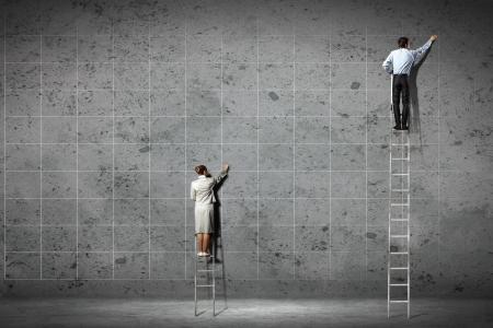 ladder: businesspeople standing on ladder drawing diagrams and graphs on wall