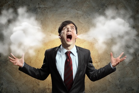businessman in anger screaming puff going out from ears photo