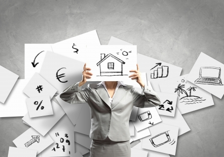 Image of businesswoman holding drawing against face  Conceptual photo photo