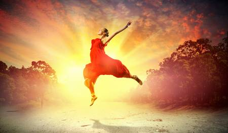 ballet dancing: Image of female ballet dancing outdoor against sunset background Stock Photo