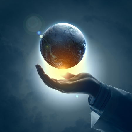 planet: Hand of businessman holding earth planet against illustration background Stock Photo
