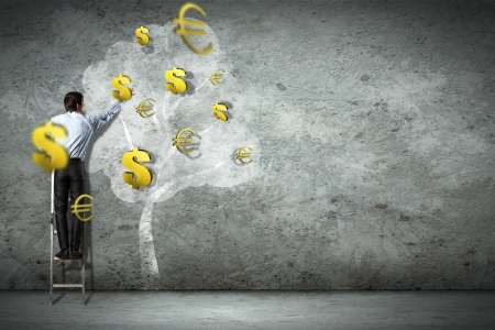 Businessman on ladder pointing at illustrated money tree photo