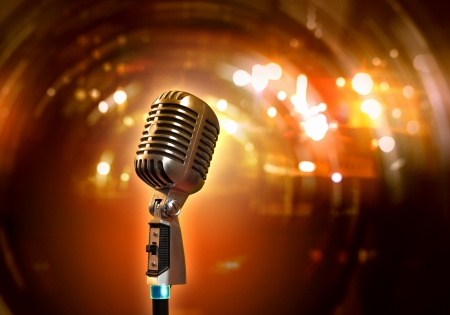 Single retro microphone against colourful background with lights photo