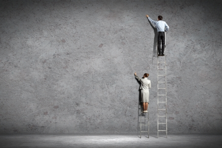 woman stairs: businesspeople standing on ladder drawing diagrams and graphs on wall