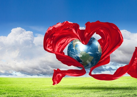 world peace: World within the heart symbol on blue sky background