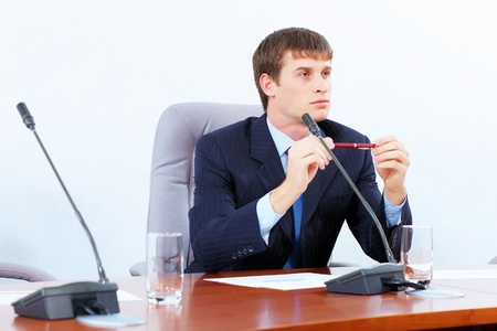 Image of young businessman sitting at table at business meeting Stock Photo - 19349239