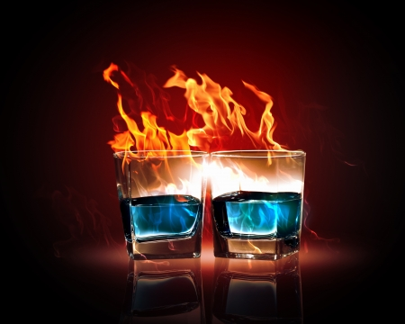Image of two glasses of burning emerald absinthe photo