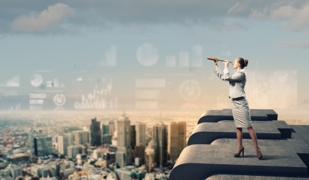 the future growth: Image of businesswoman looking in telescope standing a top of building