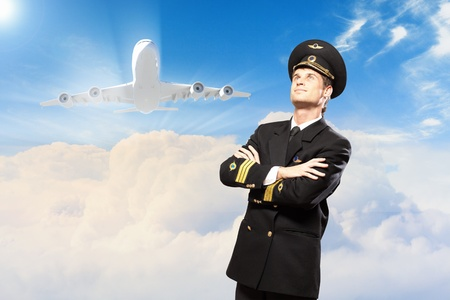 Image of male pilot with airplane at background Stock Photo - 19586754