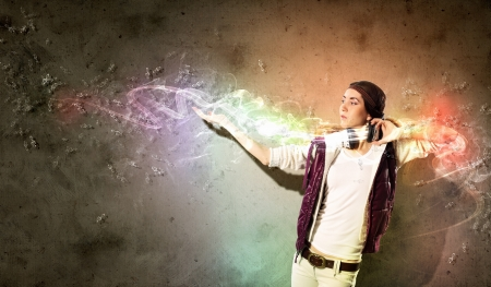 Young girl listens to music  Modulations of color and light  photo