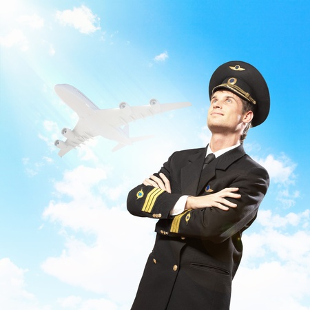 Image of male pilot with airplane at background Stock Photo - 19393502