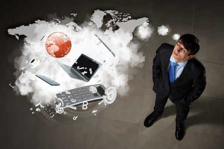 Image of business objects flying in air top view against businessman background photo