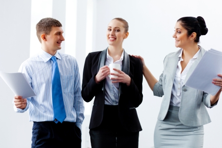 joyfully: Image of three young businesspeople laughing joyfully