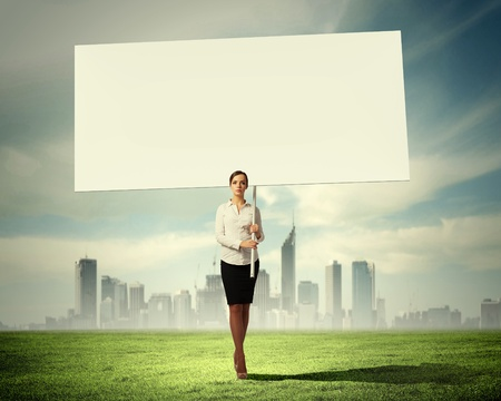 Image of attractive woman holding blank board  Place for text photo