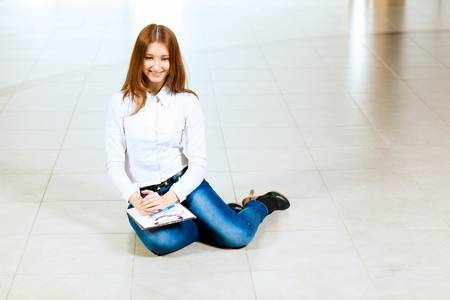Image of young red hair woman in casual wear photo