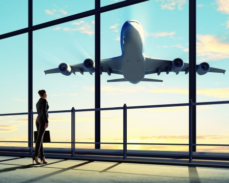 departure: Image of businesswoman at airport looking at airplane taking off